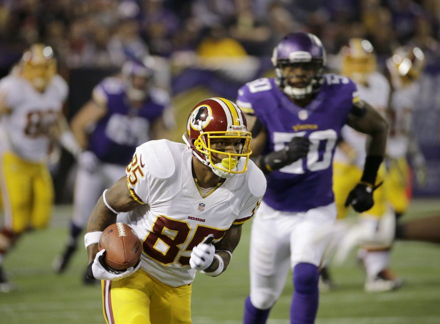 Washington Redskins wide receiver Leonard Hankerson (85) carries the ball during the first half of an NFL football game against the Minnesota Vikings Thursday, Nov. 7, 2013, in Minneapolis. (AP Photo/Ann Heisenfelt)