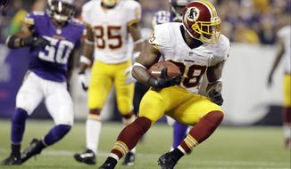 Washington Redskins wide receiver Pierre Garcon makes a cut in an NFL football game against the Minnesota Vikings, Thursday, Nov. 7, 2013 in Minneapolis. (AP Photo/Jim Mone)