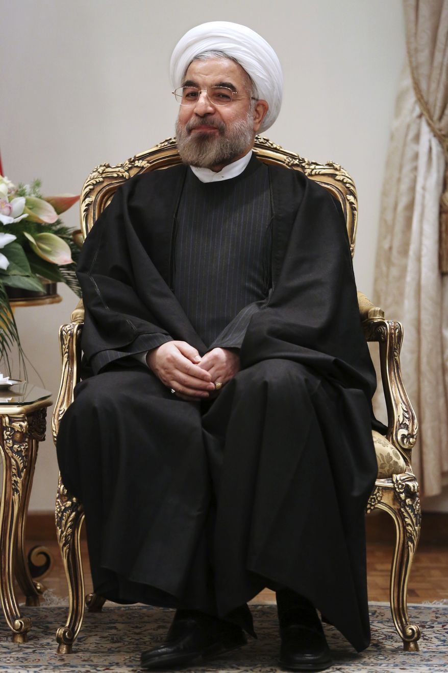 Iran's President Hassan Rouhani meets with Japan's Foreign Minister Fumio Kishida at his office in Tehran, Iran, Saturday Nov. 9, 2013. (AP Photo/Ebrahim Noroozi)