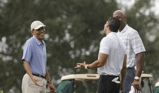 ** FILE ** President Barack Obama, left, shrugs his shoulders as he talks with former NBA basketball player Alonzo Mourning, right, and Cyrus Walker, the cousin of senior presidential adviser Valerie Jarrett, at Grande Oaks golf club, Saturday, Nov. 9, 2013 in Fort Lauderdale, Fla. (AP Photo/Pablo Martinez Monsivais)