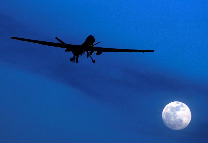 A Predator drone flies over Kandahar Air Field in Afghanistan. (Associated Press) ** FILE **