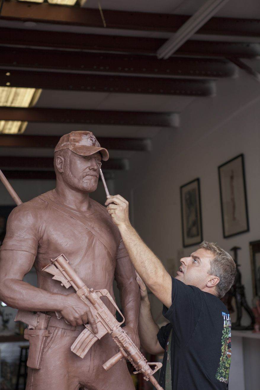 "Personal touch: ""I know it sounds crazy, but I feel their presence. That's what happens when you're creating a life-sized image of someone,"" says sculptor Gregory Marra, working on a statue of Chris Kyle, a SEAL sniper killed this year."