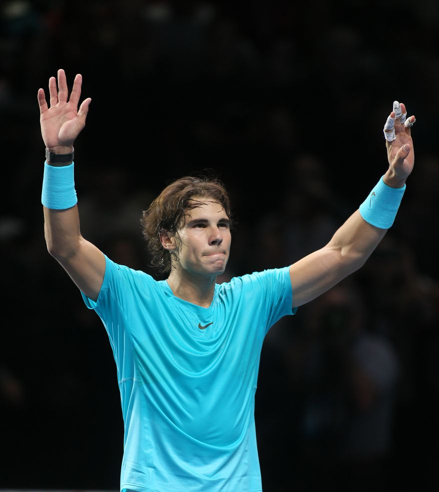 Rafael Nadal of Spain celebrates after defeating Roger Federer of Switzerland in their ATP world Tour Finals tennis semifinal match at the O2 Arena on London, Sunday, Nov. 10, 2013. (AP Photo/Alastair Grant)
