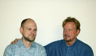 """The Rev. Frank Schaefer (right), with his son Tim, knew that United Methodist Church law forbade him from officiating at Tim's 2007 same-sex wedding in Massachusetts, but he went ahead and did it anyway """"because I love him so much and didn't want to deny him that joy."""" The decision could cost the elder Mr. Schaefer his pastor's credentials, as he faces a church trial in southeastern Pennsylvania later this month. (AP Photo/Schaefer Family)"""