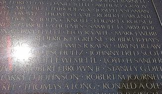 James R. Kalsu's name is visible on the Vietnam War Memorial wall in Washington, D.C., on November 10, 2013. Kalsu, a Buffalo Bills lineman, was the only active NFL player killed in Vietnam. (Nathan Fenno/The Washington Times)