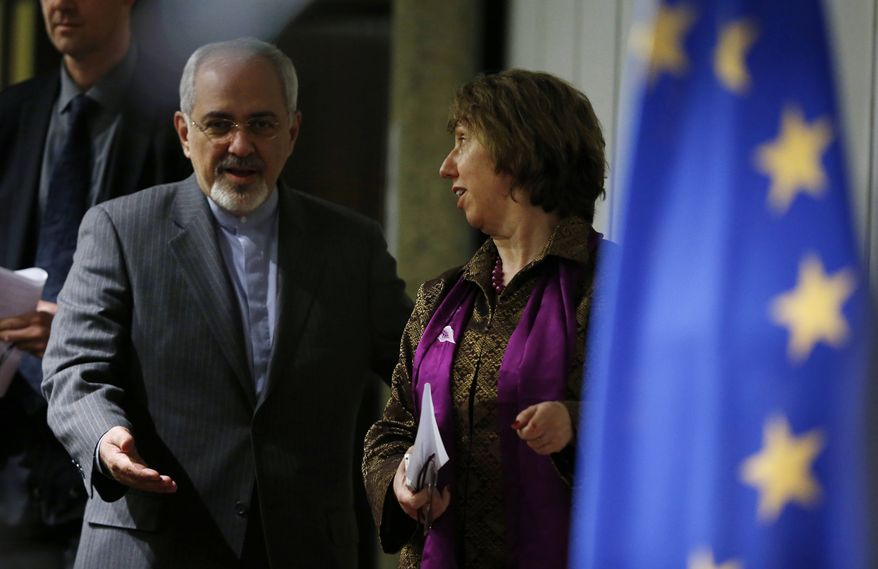 Iranian Foreign Minister Mohammad Javad Zarif (left) gestures to Catherine Ashton, the European Union's foreign policy chief, as they arrive at a press conference at the end of the Iranian nuclear talks in Geneva on Sunday, Nov. 10, 2013. The European Union's top diplomat and Iran's foreign minister said nuclear talks between six world powers and Tehran had not sealed a deal. (AP Photo/Jason Reed, Pool)