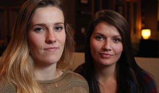 Sisters Madelyne Meylor, 20, left, and her sister Olivia, 19, of Mount Horeb, Wis., have filed a federal claim, saying they believe a cervical cancer vaccine caused their ovaries to stop producing eggs. (ASSOCIATED PRESS)