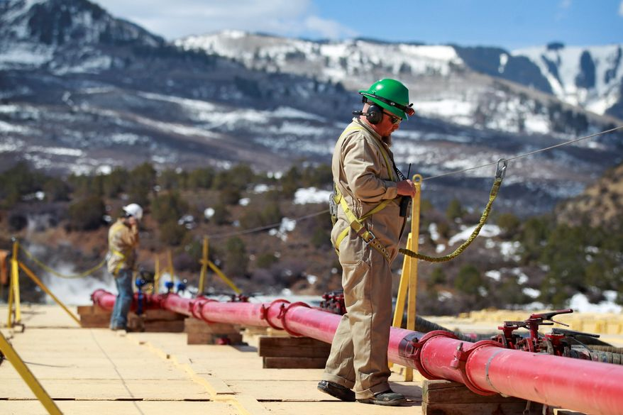 """A worker helps monitor water pumping pressure and temperature, at the site of a natural gas hydraulic fracturing and extraction operation in western Colorado. Tisha Schuller, president of the Oil and Gas Association in Colorado, said, """"Boulder and Lafayette were nothing more than symbolic votes. Lafayette's last new well permit was in the early 1990s and Boulder's last oil and gas well was plugged in 1999."""" (ASSOCIATED PRESS)"""