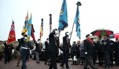 Members of the public, veterans and service personnel gather to pay their respects to World War II airman Harold Percival at Lytham Park Crematorium in Lytham St. Annes, England, on Monday, Nov. 11, 2013. Hundreds attended the funeral for Mr. Percival, who died at age 99, after a nursing home appealed for strangers to come and give him a send-off, since he had no immediate family or close friends. (AP Photo/Press Association, Lynne Cameron)