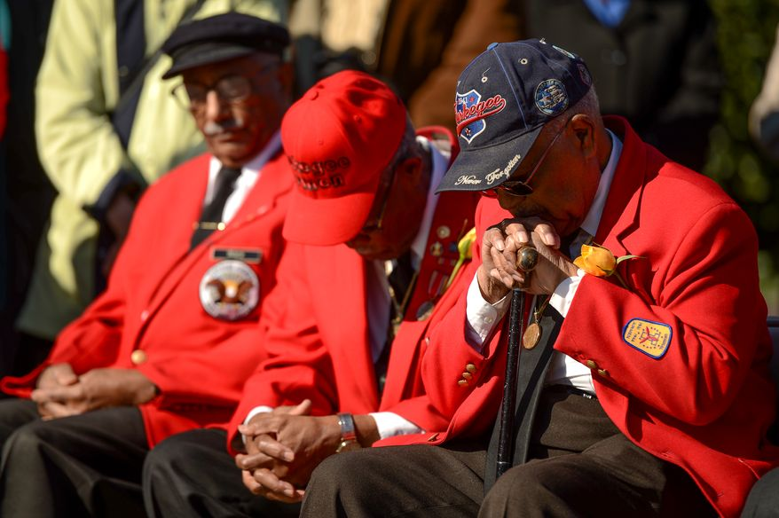 "Left to right: Documented original Tuskegee Airmen Dr. Ivan Ware, Major Anderson Jr., and William ""Bill"" Fauntroy lower their heads during a prayer at a Veterans Day Wreath Laying and Commemoration at the African American Civil War Memorial on Veterans Day, Washington, D.C., Monday, November 11, 2013. (Andrew Harnik/The Washington Times)"