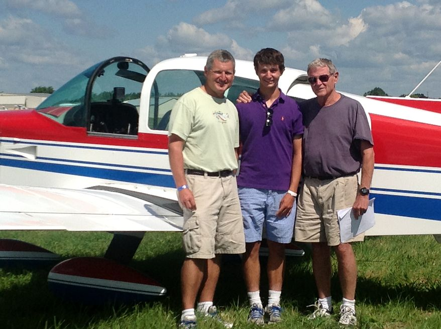 This photo Aug. 1, 2013, photo, courtesy of Sen. James Inhofe, R-Okla., shows from left, Inhofe's son Perry Inhofe, Inhofe's grandson Cole Inhofe and Sen. Inhofe in Oshkosh, Wis. Dr. Perry Inhofe was killed in a weekend plane crash in northeast Oklahoma. (AP Photo/Courtesy of Sen. James Inhofe, Ryan Jackson)
