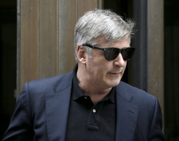 Actor Alec Baldwin leaves criminal court in New York, Tuesday, Nov. 12, 2013. Baldwin testified Tuesday that he never had a sexual or romantic relationship with Canadian actress Genevieve Sabourin, who accused of stalking him. He said that after they met, she began leaving dozens of voice mails for him a night and eventually started threatening to show up at his homes. (AP Photo/Seth Wenig)