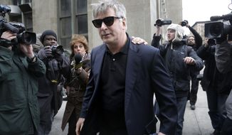 Actor Alec Baldwin leaves criminal court in New York, Tuesday, Nov. 12, 2013. Baldwin testified Tuesday that he never had a sexual or romantic relationship with Canadian actress Genevieve Sabourin, who accused of stalking him. He said that after they met she began leaving dozens of voice mails for him a night and eventually started threatening to show up at his homes. (AP Photo/Seth Wenig)