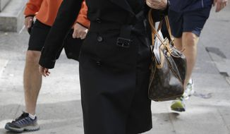 "Canadian actress Genevieve Sabourin leaves court in New York on Tuesday, Oct. 8, 2013. She is accused of stalking actor Alec Baldwin, whom she met on the set of the 2002 sci-fi comedy ""The Adventures of Pluto Nash,"" in which he had a cameo and for which she was a publicist. (AP Photo/Seth Wenig)"
