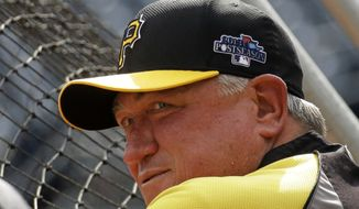 Pittsburgh Pirates manager Clint Hurdle (13) leans on the back of the batting cage during his baseball team's workout in Pittsburgh Saturday, Oct. 5, 2013. The Pirates face the St. Louis Cardinals in the third game of the National League Division Series baseball game Sunday in Pittsburgh. (AP Photo/Gene J. Puskar)