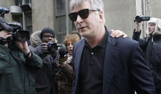 Alec Baldwin leaves criminal court in New York, Tuesday, Nov. 12, 2013. Baldwin testified Tuesday that he never had a sexual or romantic relationship with Canadian actress Genevieve Sabourin, who accused of stalking him. He said that after they met she began leaving dozens of voice mails for him a night and eventually started threatening to show up at his homes. (AP Photo/Seth Wenig)
