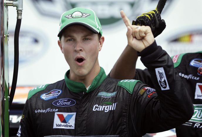 FILE - In this June 9, 2013, file photo, Trevor Bayne reacts after winning the NASCAR Nationwide auto race at Iowa Speedway in Newton, Iowa. Bayne said Tuesday, Nov. 12, 2013, that he has multiple sclerosis and he does not expect it to impact his racing career.  Bayne, who in 2011 became the youngest winner in Daytona 500 history, will still compete as scheduled at Homestead-Miami Speedway this weekend in the Nationwide and Sprint Cup Series finales. Bayne's younger sister, Sarah, also has multiple sclerosis. (AP Photo/Charlie Neibergall, File)