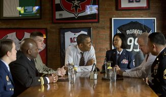 President Barack Obama and Vice President Joe Biden, second from right, meet with five active duty service members at Molly Malone's on Barracks Row in Washington, Tuesday, Nov. 12, 2013. (AP Photo/Pablo Martinez Monsivais)