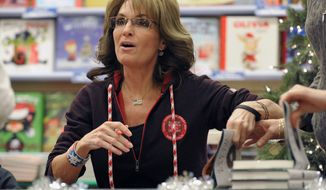 "Former Alaska Gov. Sarah Palin, the 2008 Republican vice presidential candidate, signs copies of her new book, ""Good Tidings and Great Joy: Protecting the Heart of Christmas,"" on Tuesday, Nov. 12, 2013, in Bethlehem, Pa. (AP Photo/The Express-Times, Matt Smith)"