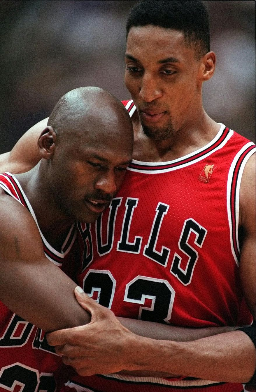 Chicago Bulls Scottie Pippen, right, embraces an exhausted Michael Jordan following their 90-88 win in Game 5 of the NBA Finals against the Utah Jazz Wednesday, June 11, 1997, in Salt Lake City.  The Bulls took a 3-2 lead in their series which moves to Chicago Friday. (AP Photo/Jack Smith)