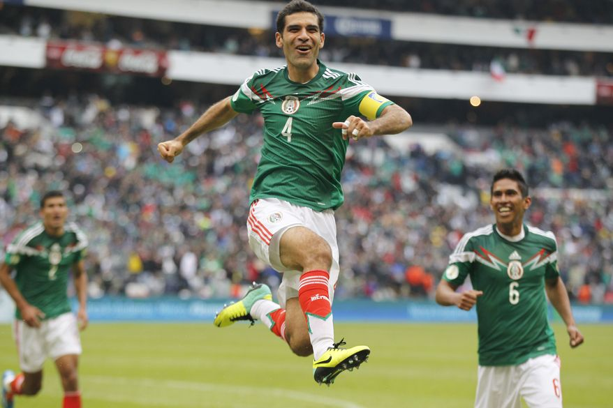 Mexico's Rafael Marquez celebrates after scoring his team's 5th goal during a 2014 World Cup playoff first round match against New Zealand in Mexico City, Wednesday, Nov. 13, 2013. (AP Photo/Eduardo Verdugo)