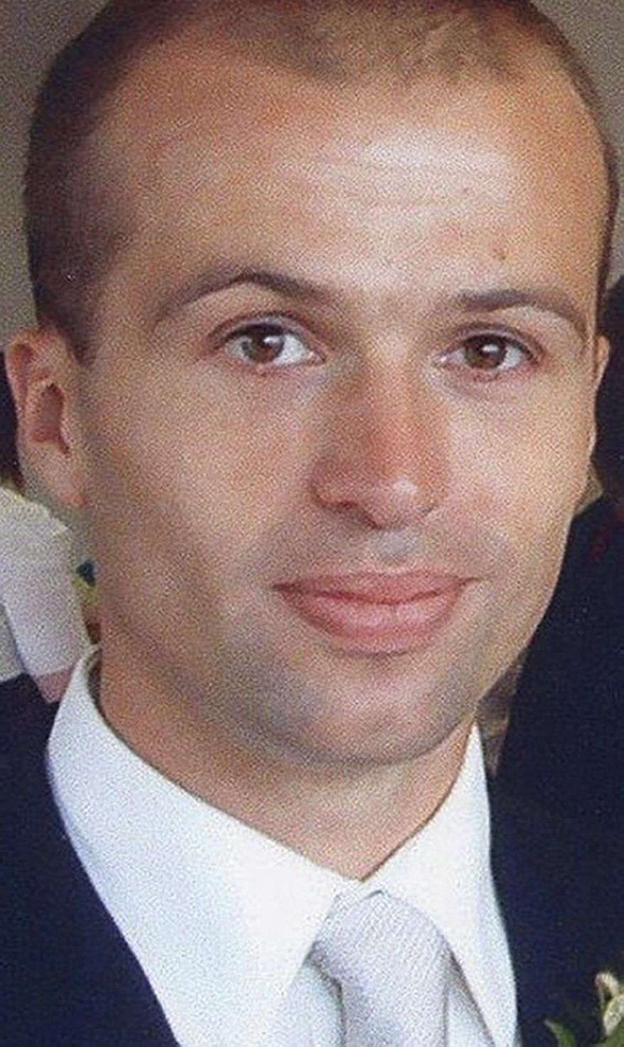 British intelligence official Gareth Williams worked for the United Kingdom's secret eavesdropping service, GCHQ, but was attached to the country's MI6 overseas spy agency when his naked and decomposing remains were found in 2010 at his central London apartment. Scotland Yard said on Wednesday, Nov. 13, 2013, that Williams likely died in an accident with no one else involved. (AP Photo/Metropolitan Police)