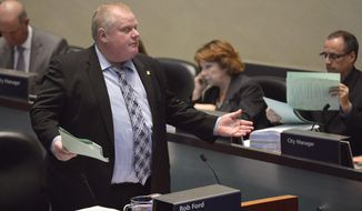 Mayor Rob Ford speaks at Toronto's City Council on Wednesday, Nov. 13, 2013. Almost every member of the council stood up and asked Ford to take a leave of absence Wednesday after he admitted smoking crack last week. (AP Photo/The Canadian Press, Nathan Denette)