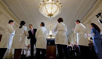 President Barack Obama greets doctors and nurses following his remarks about health care reform in the East Room of the White House, March 3, 2010. (Official White House Photo by Chuck Kennedy)