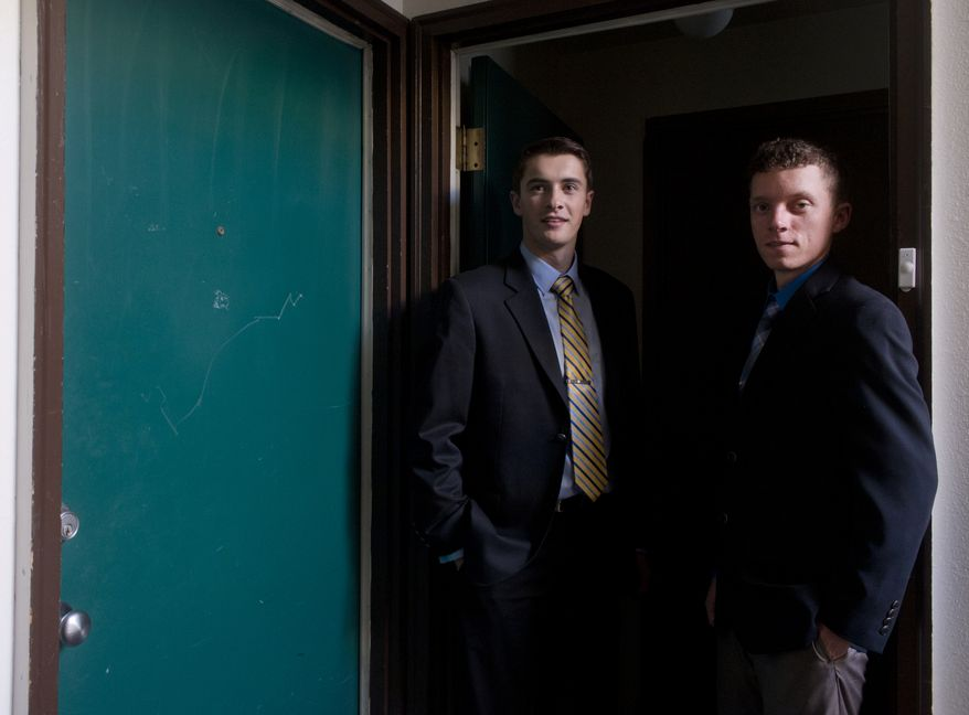 Gonzaga University students Erik Fagan (left) and Dan McIntosh stand in the doorway at their college-owned apartment on Friday, Nov. 8, 2013, in Spokane, Wash. They face expulsion for having a gun in a campus apartment. (AP Photo/The Spokesman-Review, Jesse Tinsley)