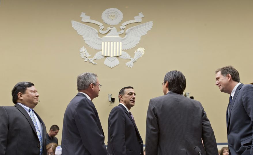 Rep. Darrell E. Issa (center), California Republican, speaks with Obama administration technology officials as they prepare to testify before the House Oversight and Government Reform Committee about failures with the HealthCare.gov website and problems implementing Obamacare, on Capitol Hill in Washington on Wednesday, Nov. 13, 2013. From left to right are Henry Chao, deputy chief information officer for Medicare and Medicaid services; Frank Baitman, deputy assistant secretary for information technology at the Department of Health and Human Services; Mr. Issa, chairman of the committee; Todd Park, chief technology officer at the White House Office of Science and Technology Policy; and Steve VanRoekel, chief information officer at the Office of Electronic Government in the Office of Management and Budget. (AP Photo/J. Scott Applewhite)