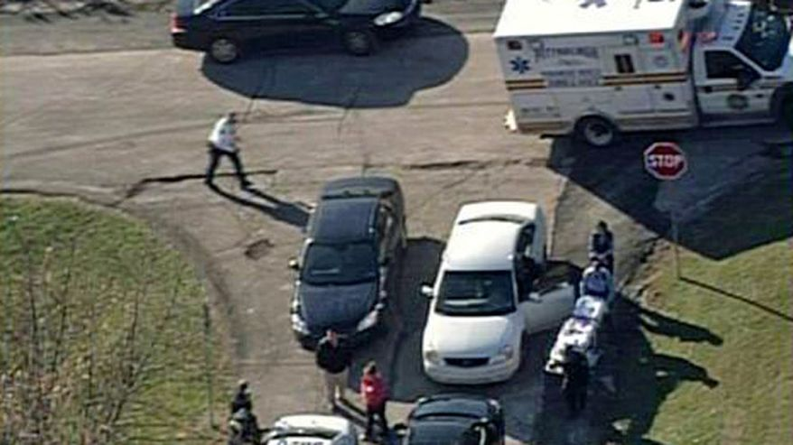 In this image provided by KDKA- TV emergency personal respond to a shooting at the scene near  Brashear High School, Monday, Nov. 13, 2013, in Pittsburgh. Pittsburgh police reported Monday that three people were shot near the school. (AP Photo/KDKA- TV)