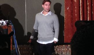 Ryan Ferguson arrives Tuesday night, Nov. 12, 2013, at the Tiger Hotel, in Columbia, Mo., to speak to supporters after being freed from prison earlier in the evening. Ferguson was released one week after a state appeals court overturned his murder and robbery convictions in the 2001 slaying of Columbia Daily Tribune sports editor Kent Heitholt. His release followed a decision Tuesday by the Missouri attorney general not to re-try Ferguson. (AP Photo/David A. Lieb)