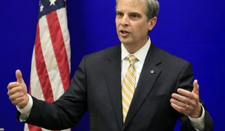 State Sen. Mark Obenshain, R-Harrisonburg, Republican candidate for Attorney General,  gestures during a new conference at the Capitol Wednesday, Nov. 13, 2013, in Richmond, Va.  Trailing by 164 votes, Obenshain announced his transition team, hours after Democrat candidate Mark Herring announced his own transition team.  The state's Board of Elections won't certify Virginia's voting until Nov. 25. (AP Photo/Steve Helber)