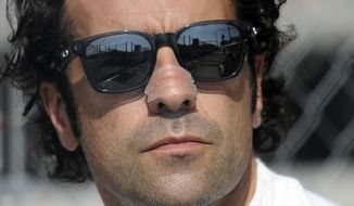 Dario Franchitti, of Scotland, watches a warm up session for the IndyCar Grand Prix of Baltimore auto race, Sunday, Sept. 1, 2013, in Baltimore. (AP Photo/Nick Wass)