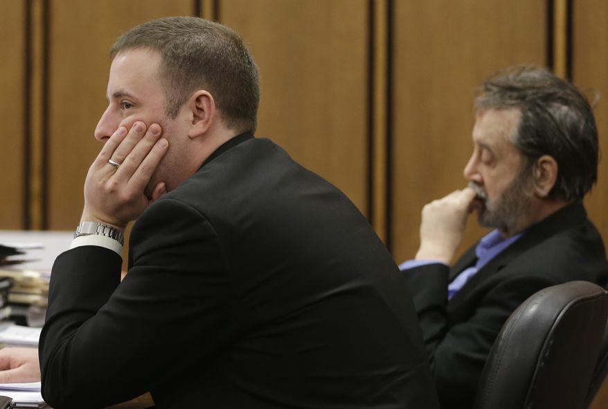 Defense attorney Joseph Patituce (left) and Bobby Thompson, whom authorities have identified as Harvard-trained lawyer John Donald Cody, listen during closing statements by the prosecution on Wednesday, Nov. 13, 2013, in Cleveland. Thompson was convicted on Thursday of defrauding the United States Navy Veterans Association, a charity he ran from Tampa, Fla. (AP Photo/Tony Dejak)