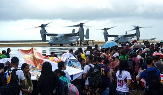 In this Thursday, Nov. 14, 2013, photo provided by the Navy Media Content Service (NMCS), a MV-22 Ospreys, load supplies to provide aid during Operation Damayan. The George Washington Carrier Strike Group and the 3rd Marine Expeditionary Brigade are assisting the Philippine government in response to the aftermath of typhoon Haiyan/Yolanda in the Republic of the Philippines. (AP Photo/ NMCS 3rd Class Ricardo R. Guzman/Released)