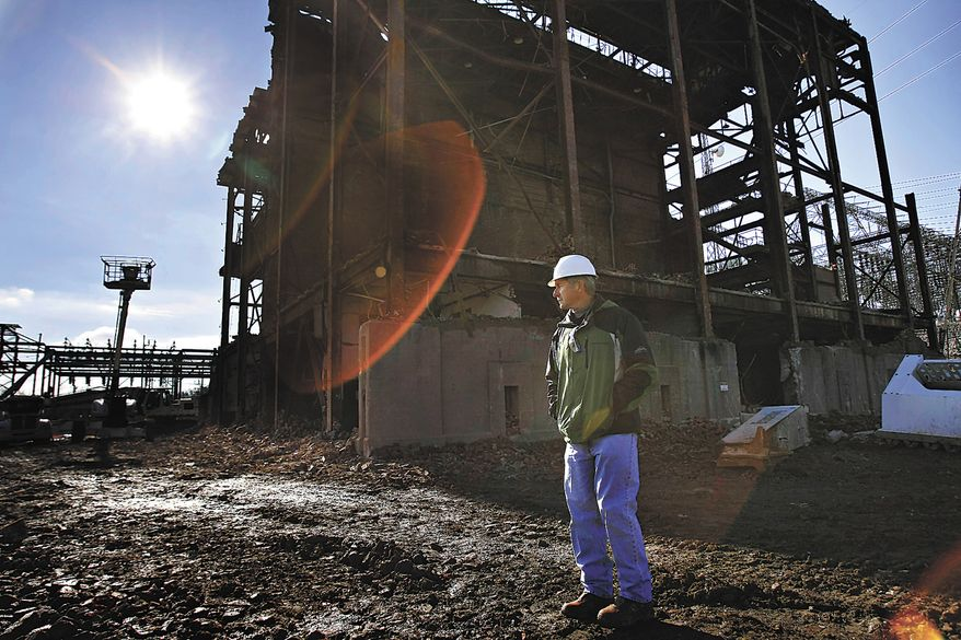 ** FILE ** Donald Crabtree, a Tennessee Valley Authority project manager from Stevenson, Ala., leads a media tour around the old Bowling Green, Ky., power plant on Power Street, which was torn down to allow for TVA expansion, on Wednesday Nov. 30, 2011. (AP Photo/Daily News, Alex Slitz)