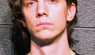 File - This March 5, 2012 file photo provided by the Cook County Sheriff's Department in Chicago shows Jeremy Hammond. A New York judge sentenced Hammond to ten years, Friday, Nov. 15, 2013 for his involvement in cyber-attacks on corporations and government agencies worldwide. (AP Photo/Cook County Sheriff's Department, File)