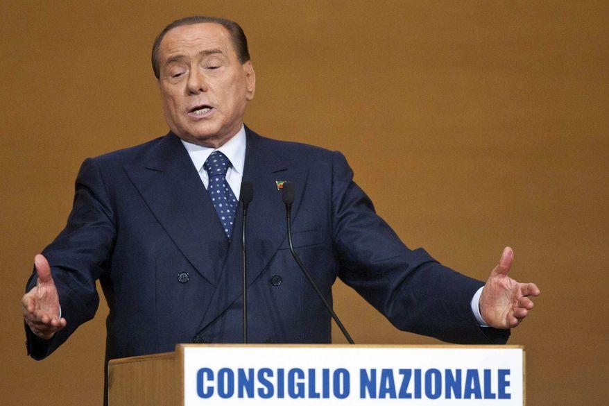 ** FILE ** Silvio Berlusconi gestures as he addresses supporters in Rome, Saturday, Nov. 16, 2013. (AP Photo/Mauro Scrobogna, Lapresse)