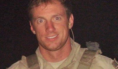 Killed in action: Chief Petty Officer Aaron Vaughn was one of the victims of a poorly planned Afghanistan mission in August 2011, his father says in a book. (Associated Press)