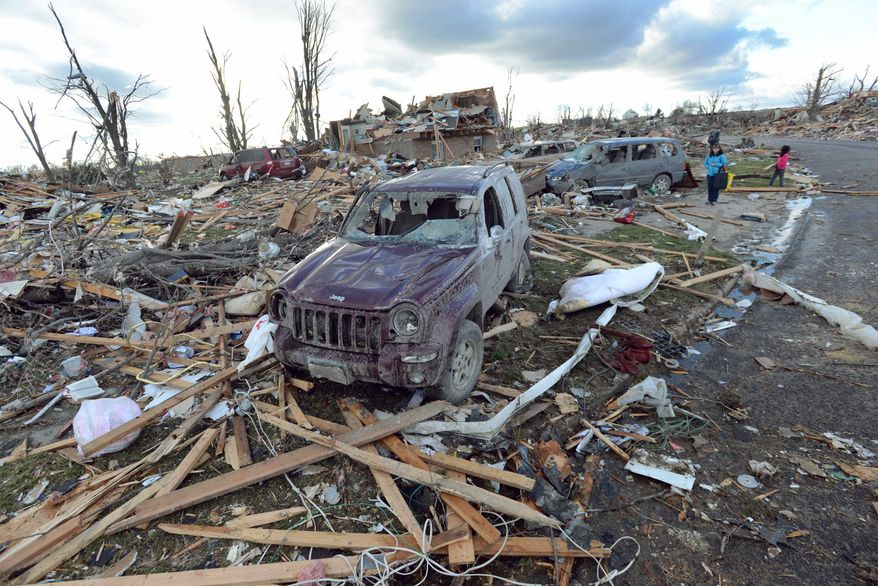 Demolished homes and vehicles in the Devonshire Subdivision in Washington, Ill., Sunday, Nov. 17, 2013. Intense thunderstorms and tornadoes swept across the Midwest, causing extensive damage in several central Illinois communities while sending people to their basements for shelter. (AP Photo/The Pantagraph, Steve Smedley)