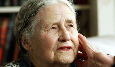 """Doris Lessing, pictured in 2006 at age 86 in her home in north London, was the free-thinking, world-traveling, often-polarizing writer of """"The Golden Notebook"""" and dozens of other novels that reflected her own improbable journey across the former British Empire. The Nobel Prize-winning author died on Sunday, Nov. 17, 2013, at age 94. (AP Photo/Martin Cleaver)"""