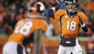 Denver Broncos quarterback Peyton Manning (18) throws to running back Montee Ball (28) against the Kansas City Chiefs in the fourth quarter of an NFL football game, Sunday, Nov. 17, 2013, in Denver. (AP Photo/Joe Mahoney)