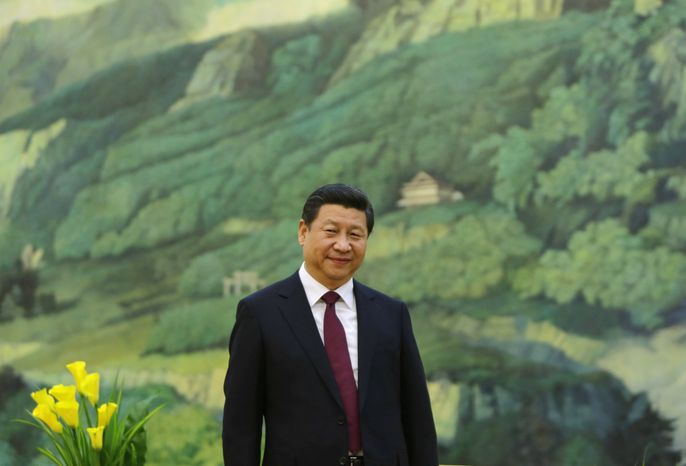 China's President Xi Jinping attends a meeting with former U.S. President Bill Clinton at the Great Hall of the People, in Beijing, Monday, Nov. 18, 2013. (AP Photo/Jason Lee, Pool)