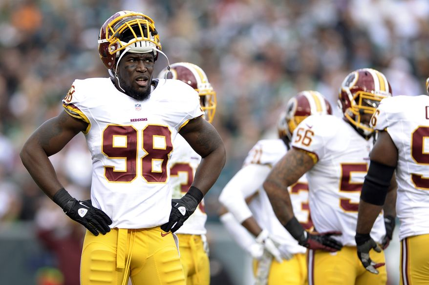 Washington Redskins outside linebacker Brian Orakpo pauses during the first half of an NFL football game against the Philadelphia Eagles in Philadelphia, Sunday, Nov. 17, 2013. (AP Photo/Michael Perez)