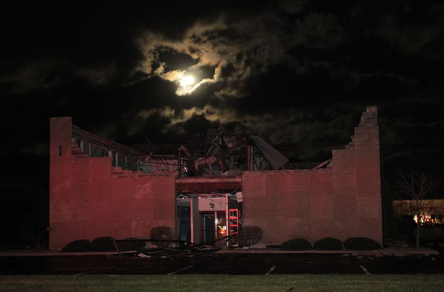 Heavy damage to the roof of the HP building from a tornado is seen on Hoffer Street, Sunday, Nov. 17, 2013, in Kokomo, Ind. (AP Photo/The Indianapolis Star, Brent Drinkut)