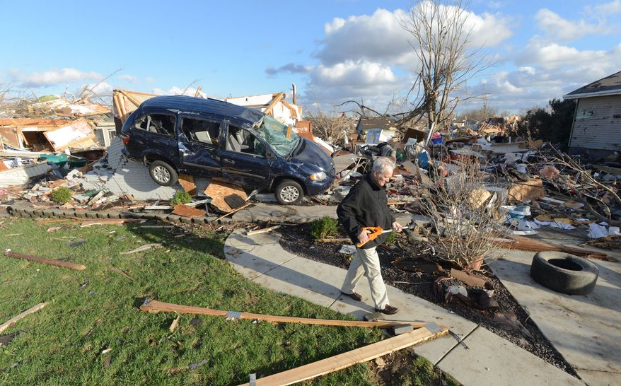 Richard Miller of Washington, Illinois salvages items from his brothers home, after a tornado leveled a subdivision on the North side of Washington, Ill., Sunday, Nov. 17, 2013. Intense thunderstorms and tornadoes swept across the Midwest, causing extensive damage in several central Illinois communities while sending people to their basements for shelter. (AP Photo/The Pantagraph, Steve Smedley)