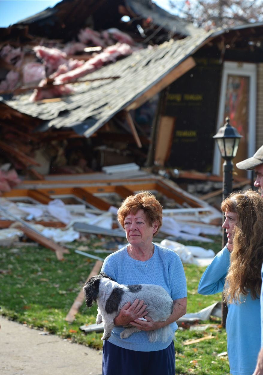 Shirley Wolf says she hung on to her dog Sammy for dear life as a tornado destroyed her home at 306 Delshire in Pekin, Il.,Sunday, Nov. 17, 2013. Intense thunderstorms and tornadoes swept across the Midwest on Sunday, causing extensive damage in several central Illinois communities while sending people to their basements for shelter. (AP Photo/Journal Star, Fred Zwicky) MANDATORY CREDIT