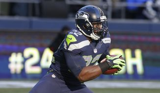 Seattle Seahawks running back Marshawn Lynch runs the ball against the Minnesota Vikings in the first half of an NFL football game, Sunday, Nov. 17, 2013, in Seattle. (AP Photo/Ted S. Warren)