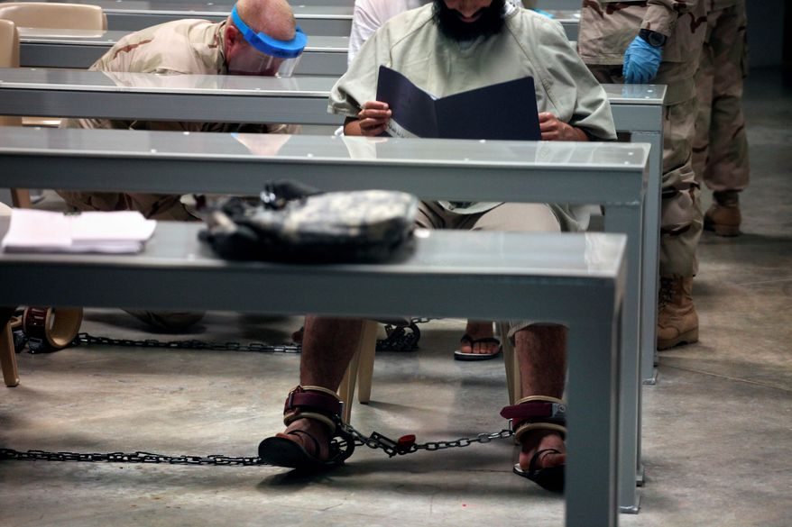 Bookworms: Guantanamo detainees are given reading material as they learn about horticulture, nutrition, various art techniques and other skills as part of a $5 million U.S. program. (Associated Press)